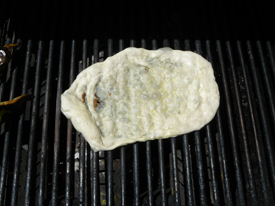 Grilled pizza dough puffing up