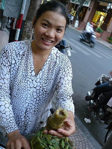 Street vendor selling bananas in sticky rice (banh tet chuoi)