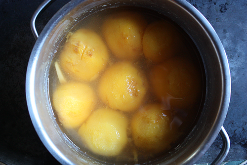 Poached peaches with ginger in pot