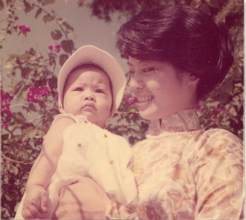 My mom with her first-born, circa 1960.