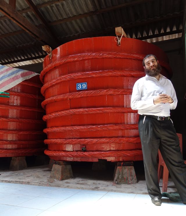 Red boat fish sauce Rabbi Hartman standing