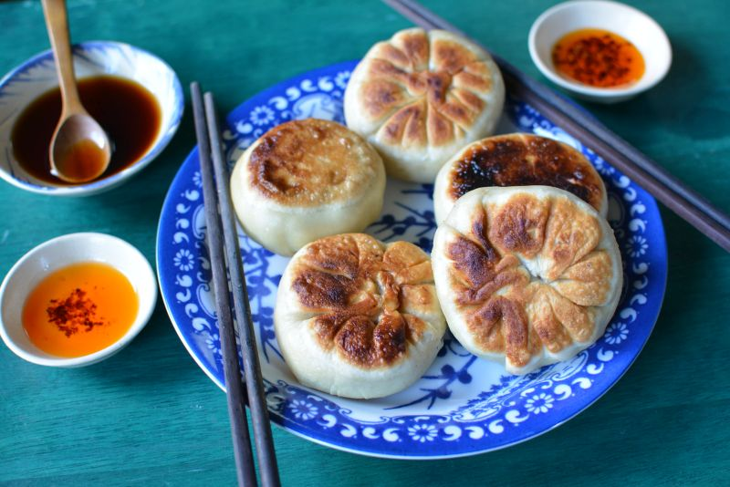 Chinese beef and celery hearts meat pies recipe xian bing viet meet xian bing pan fried dumplings the size hockey pucks they are shaped like traditional bao but the dough does not contain any leavening agent forumfinder Images