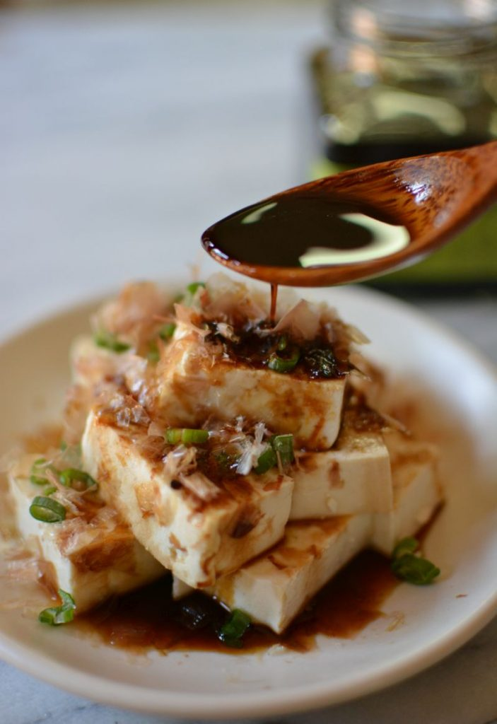 Japanese umami soy concentrate being used on tofu.